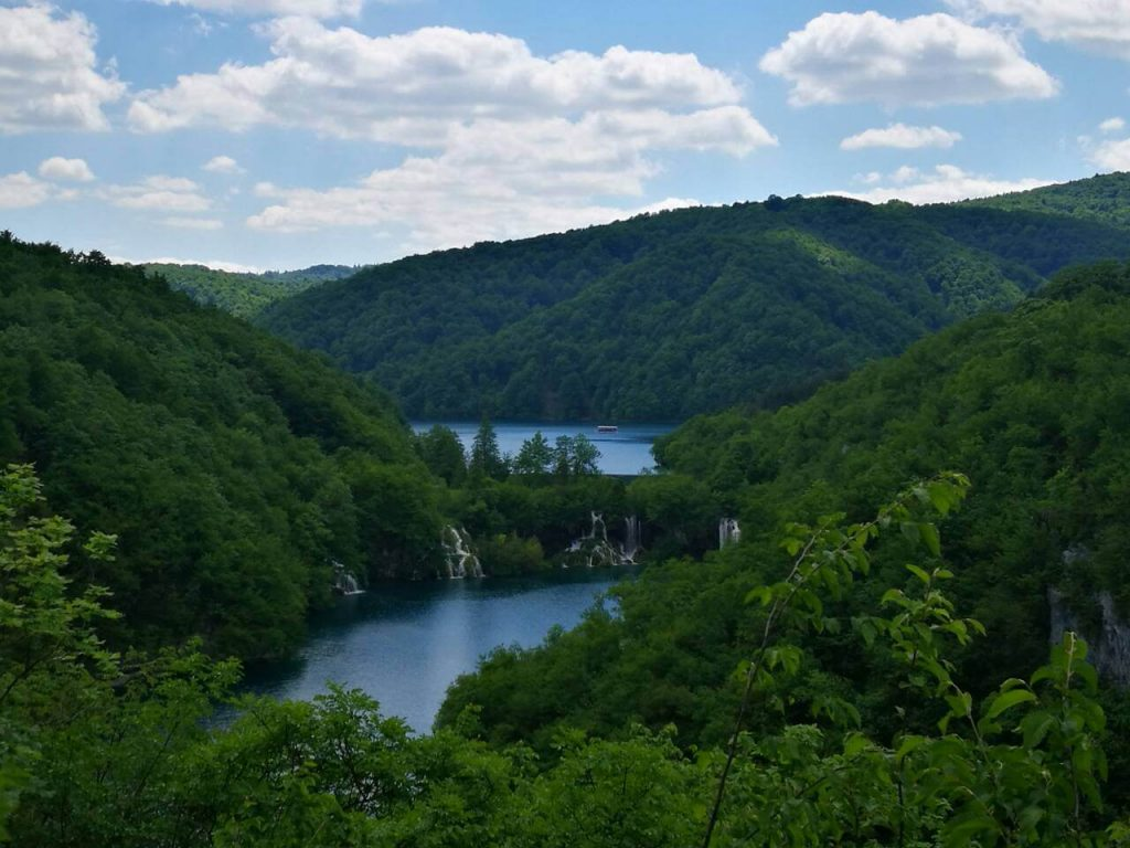 Panoramic view with blue lakes and green trees at Plitvice Lakes in Croatia