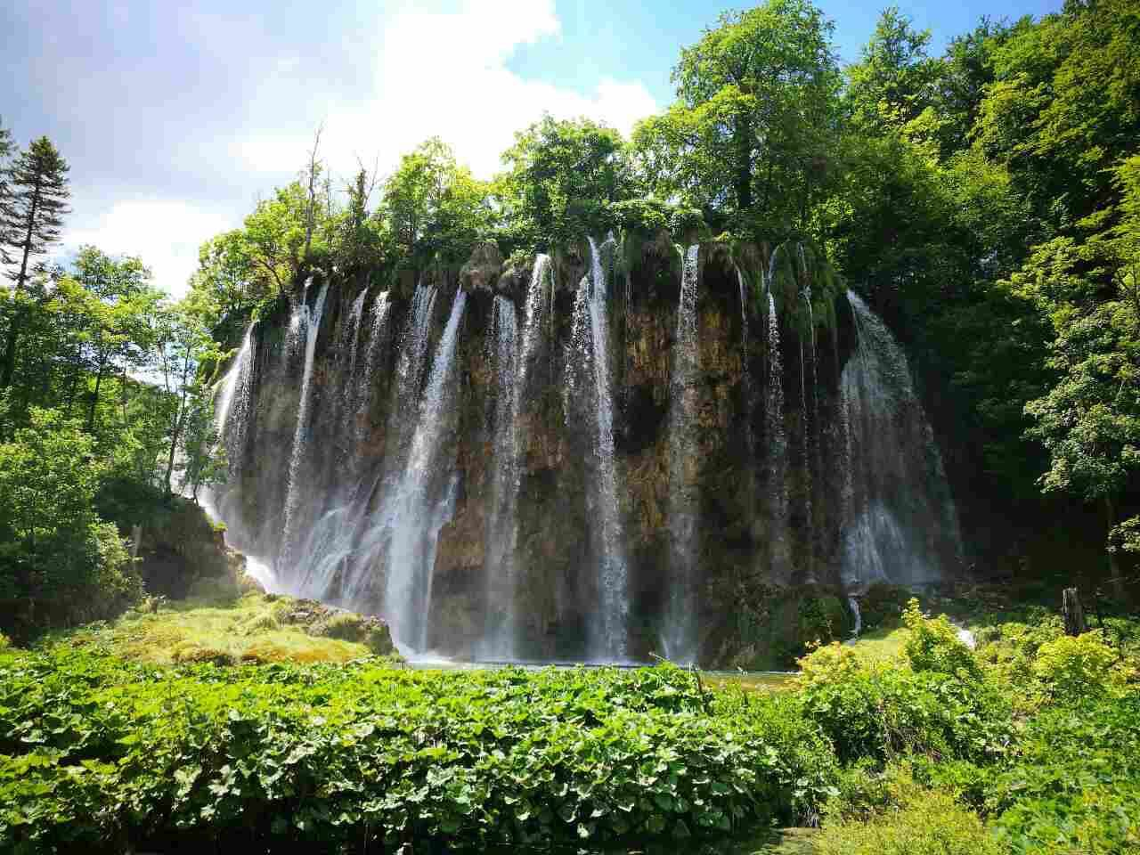 Waterfalls and green trees at Plitvice Lakes in Croatia