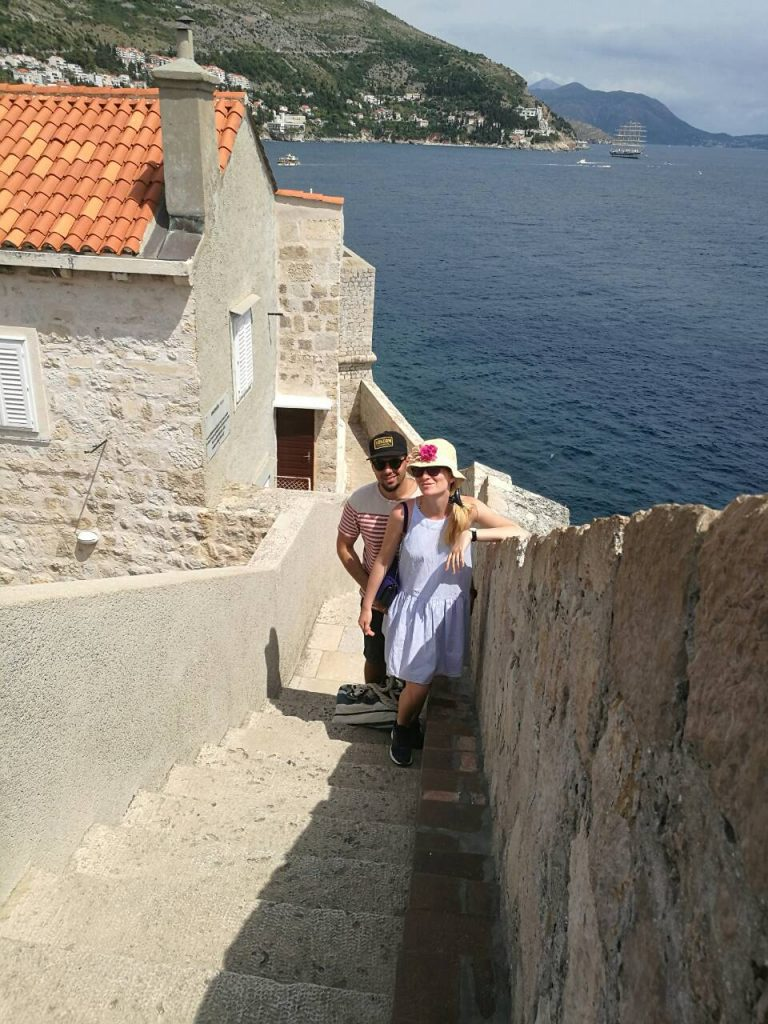 Young couple on stairs at the city walls of Dubrovnik, Croatia