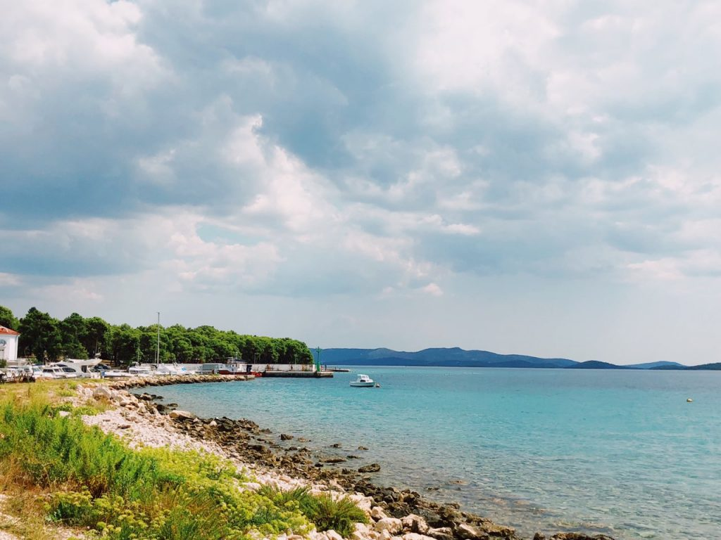 Rocky beach, blue sea and cloudy sky in Zablace, Croatia