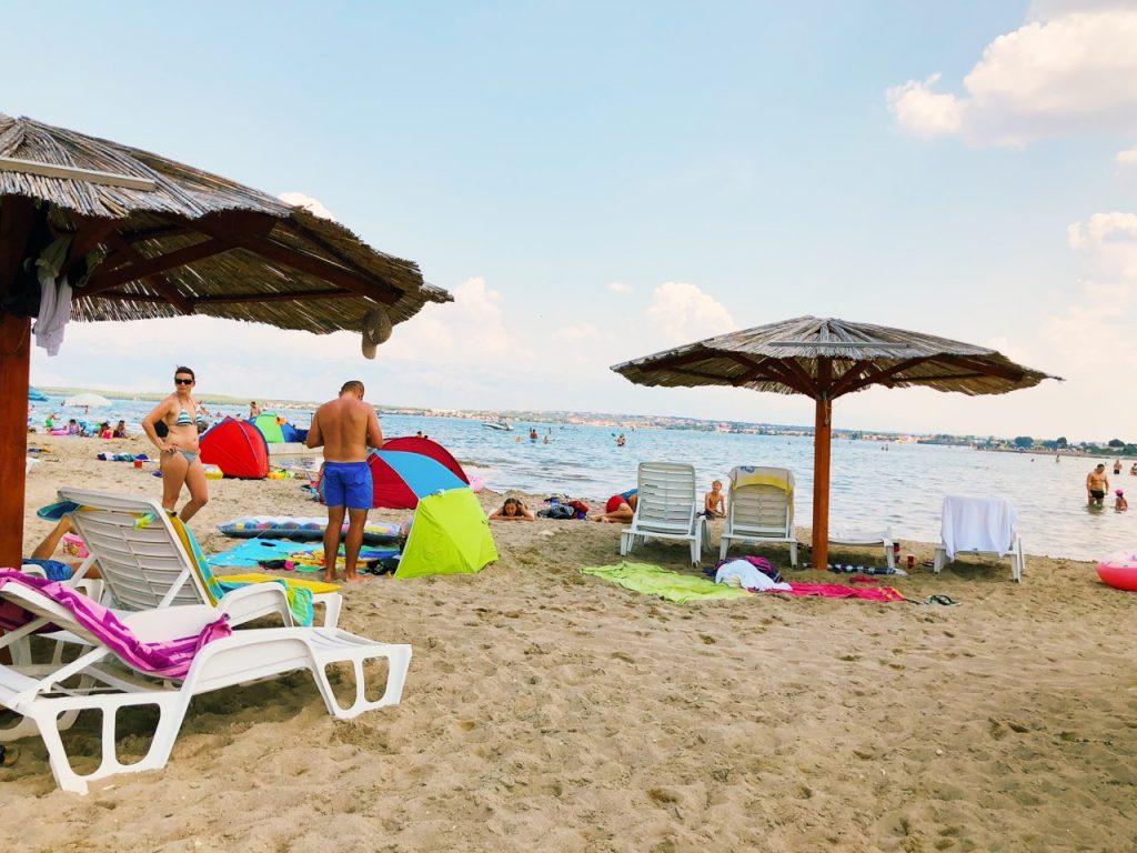 Sandy beach, umbrellas and the sea at Queen's beach
