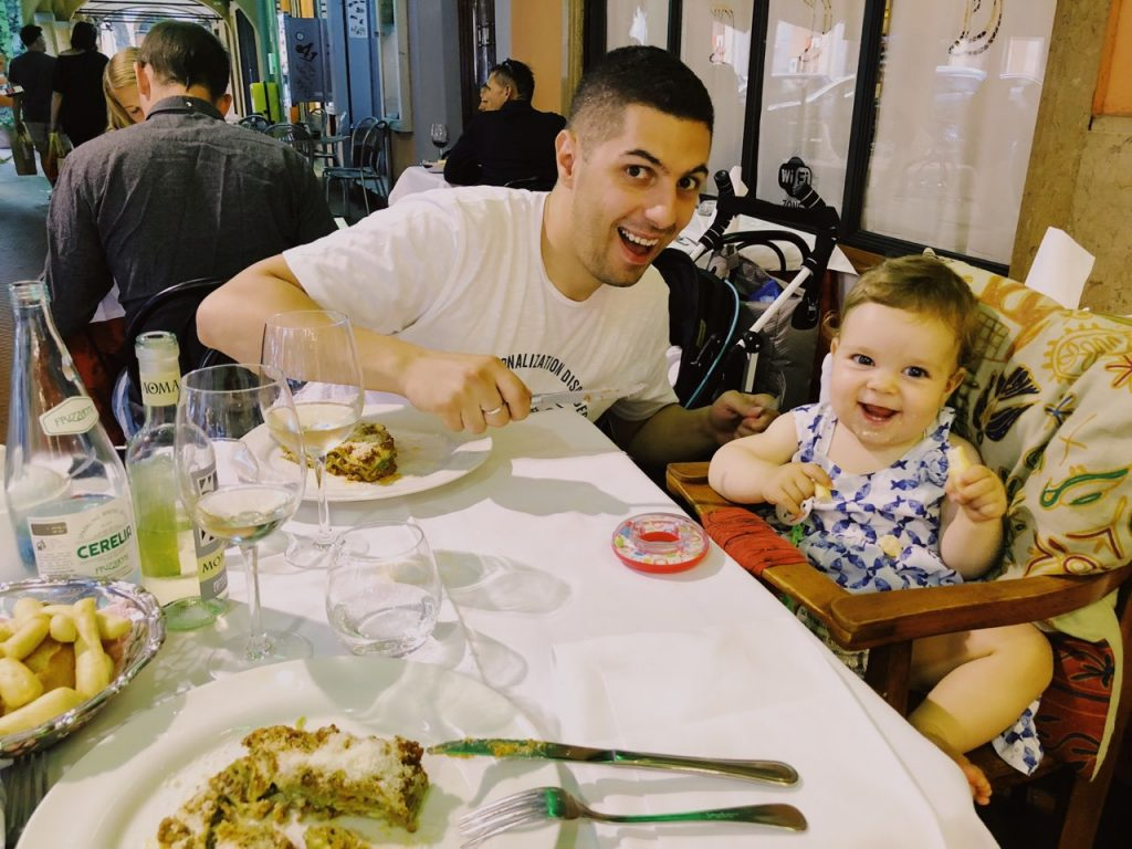 Father and baby girl enjoy dinner at restaurant Donatello in Bologna