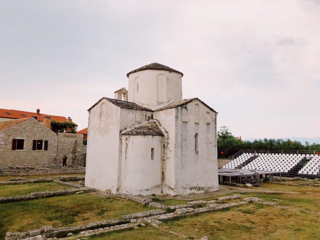Small white church in Nin, Croatia, called Church of the Holy Cross