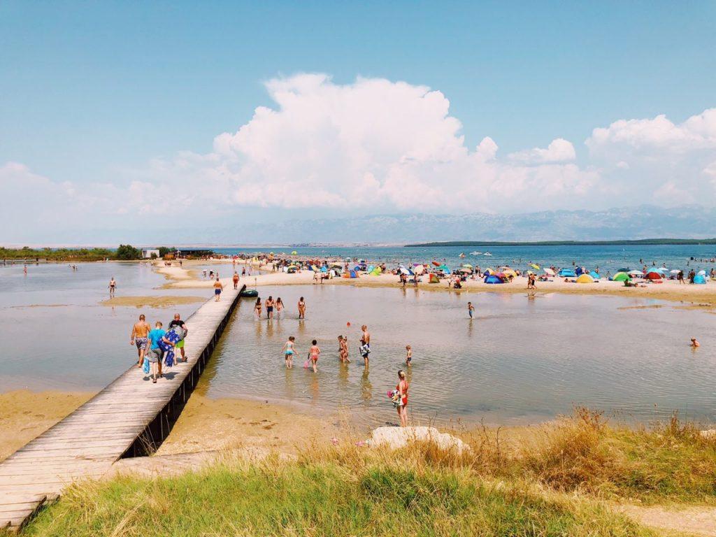 Wooden bridge and people at Queen's beach in Nin, Croatia