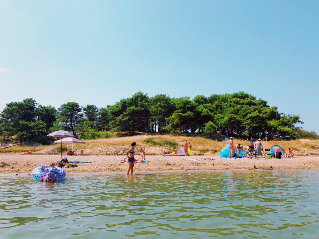 People at Queen's beach in Nin, Croatia