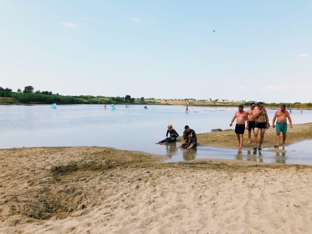 People putting on medicinal mud at Ninsko blato in Croatia