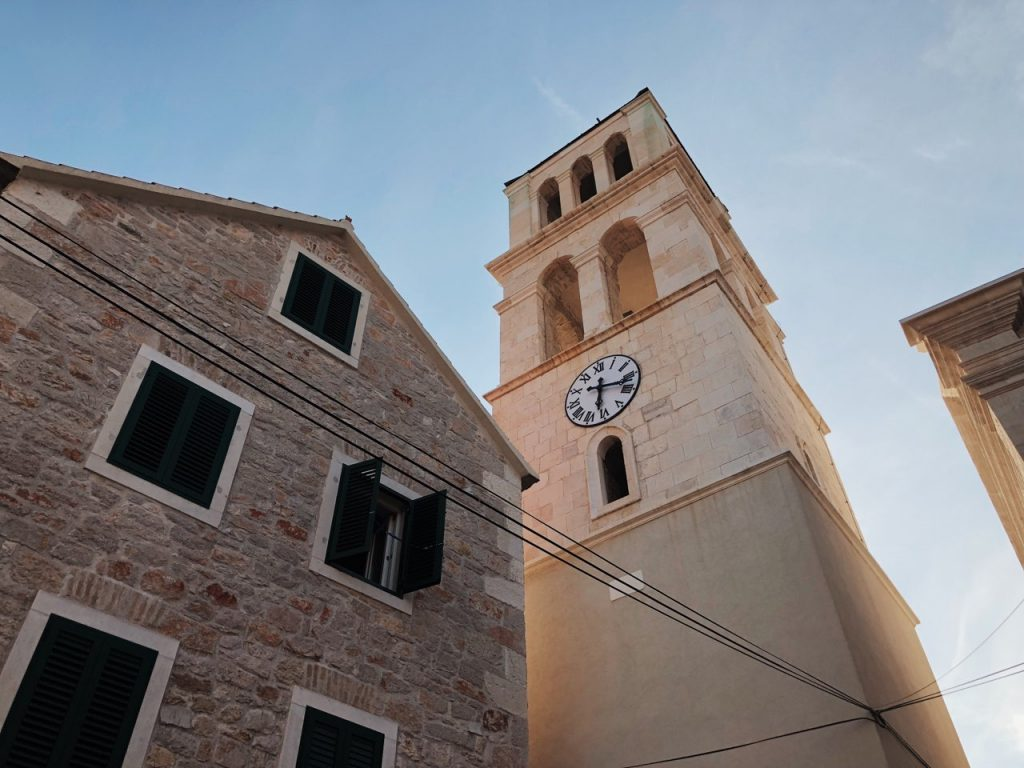 Mediterranean building and a tower clock in Vodice, Croatia