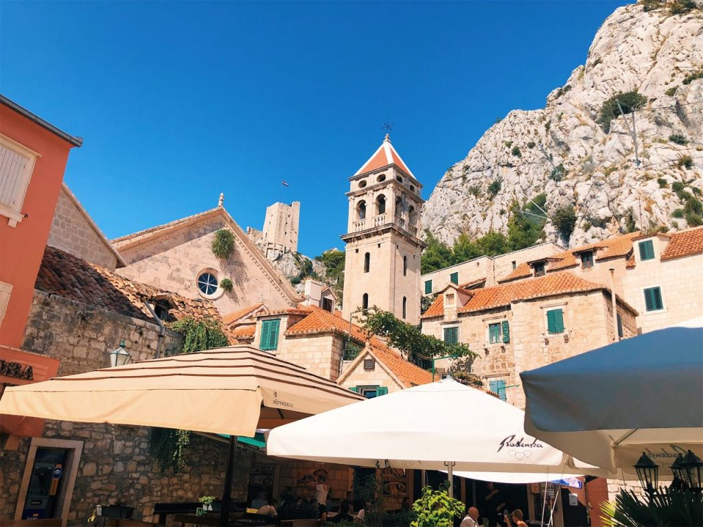 Houses, church and bell tower in the old town of Omis, Croatia
