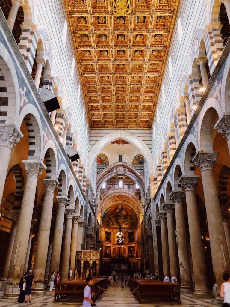 Golden roof and columns inside the cathedral of Pisa in Italy