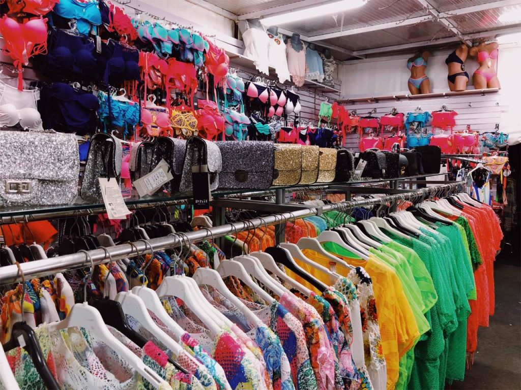 Colorful swimsuits, bags and blouses in a store in Makarska, Croatia