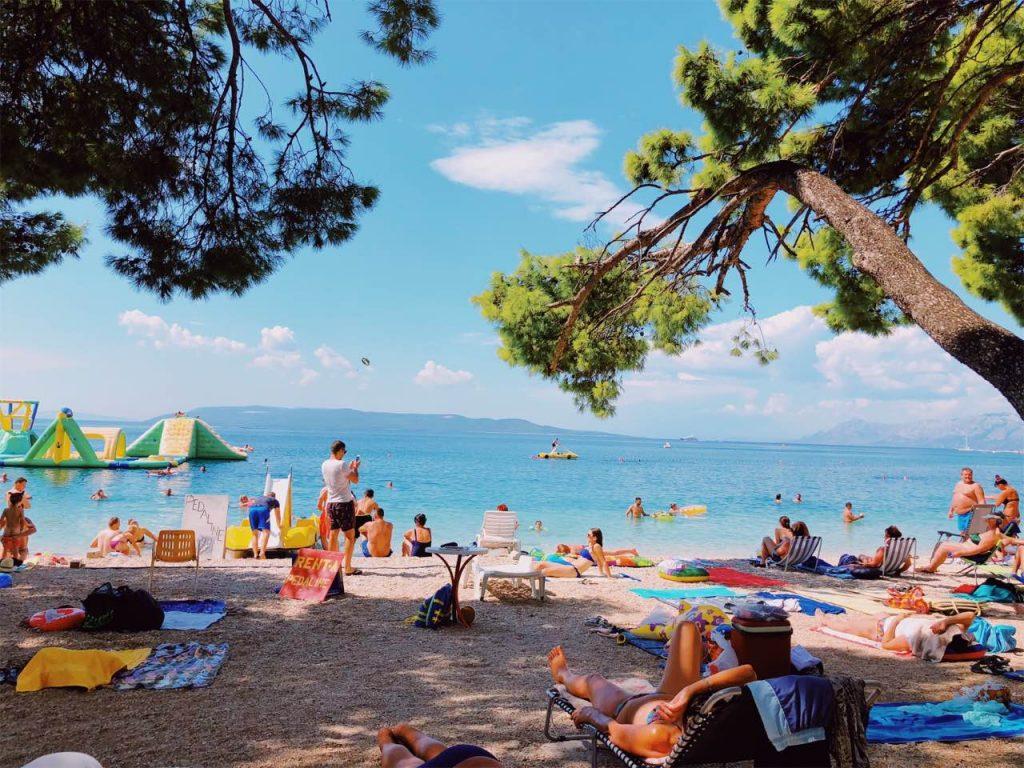 Blue sky, blue sea and people at the beach in Makarska, Croatia