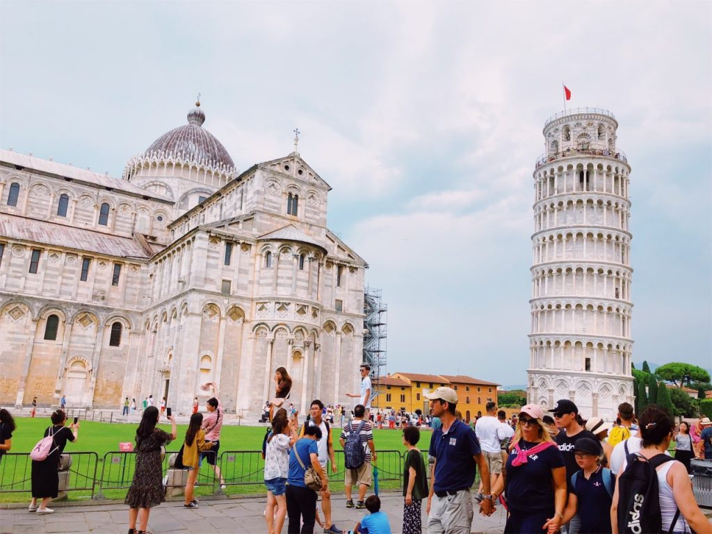 Tourists at The Field of Miracles (Piazza dei Miracoli) in Pisa, Italy