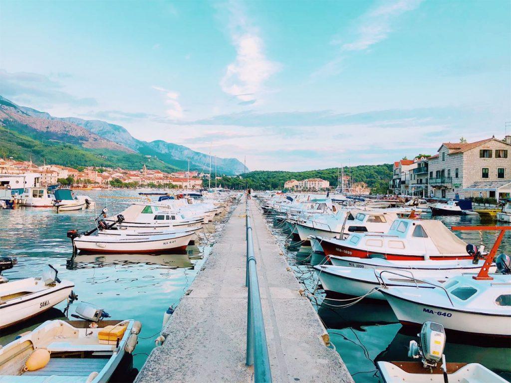 Boats and blue sky at the harbor in Makarska, Croatia