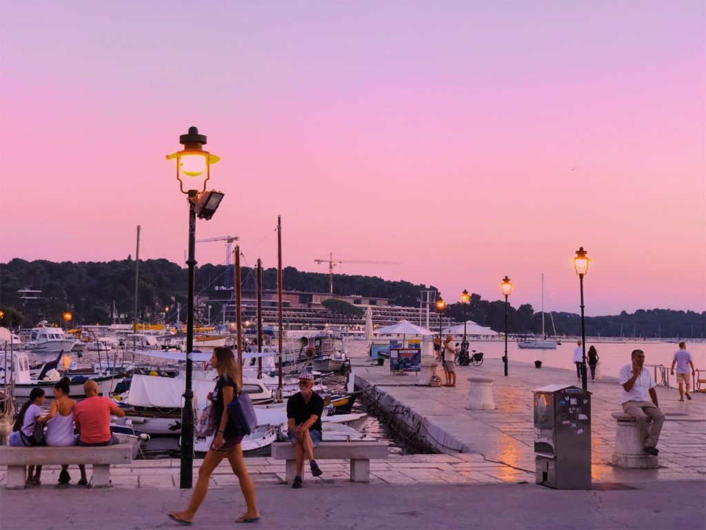 Pink sunset at the harbor in Rovinj, Croatia