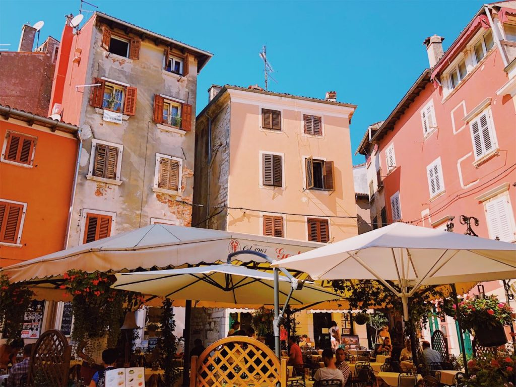 Restaurants and colorful Mediterranean buildings in Rovinj, Croatia
