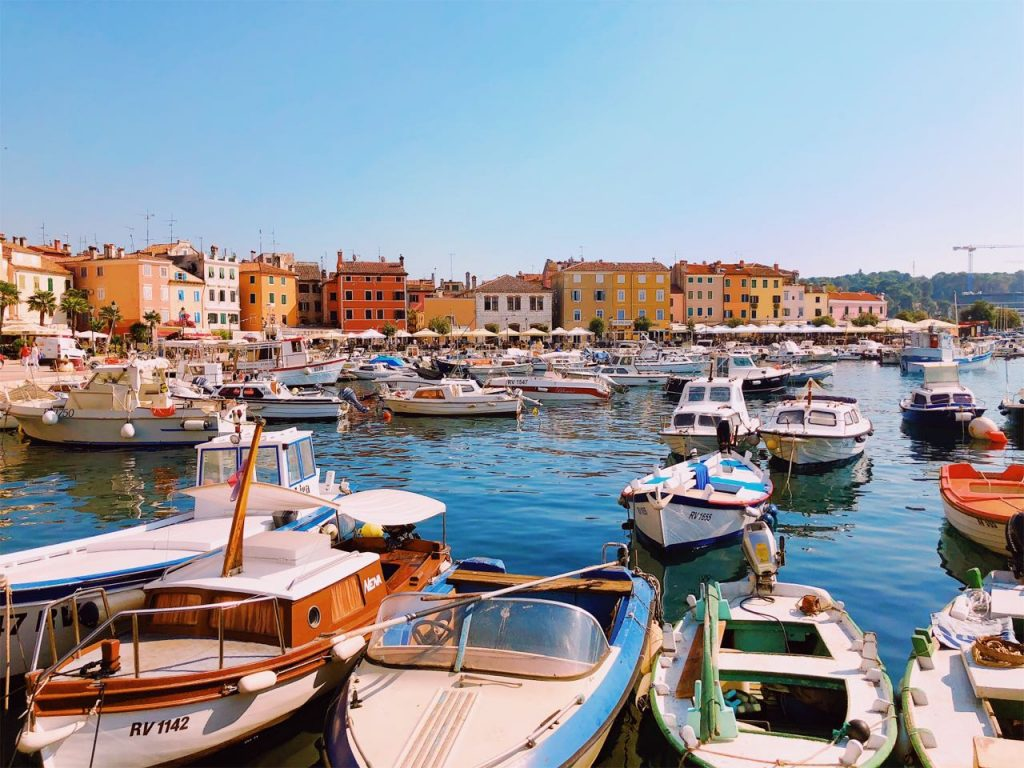 Boats and colorful Mediterranean buildings in Rovinj, Croatia