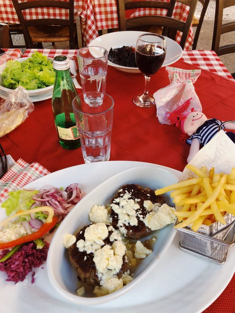 Drinks, salad and meat meal in Pula, Croatia