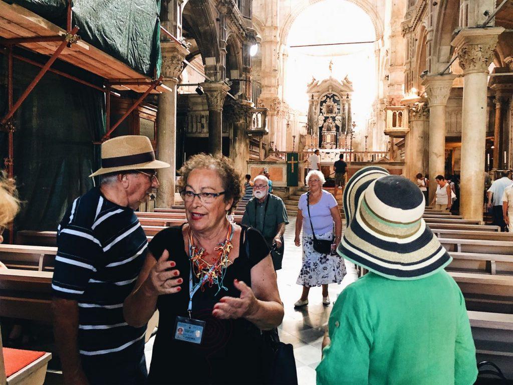 Jasenka Ramljak and tourists at the St. James cathedral in Sibenik, Croatia
