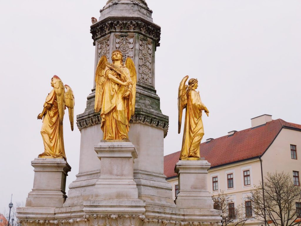 Golden statue in front of the Zagreb cathedral