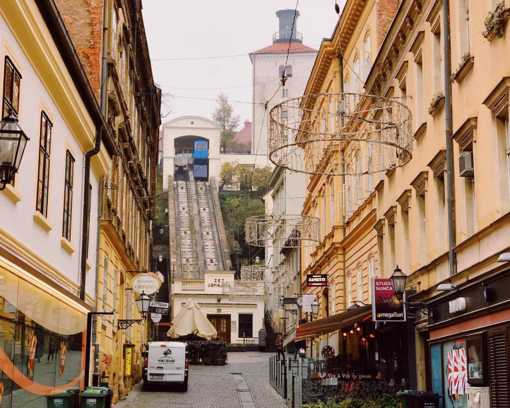 The funicular in Zagreb with Lotrščak Tower next to it