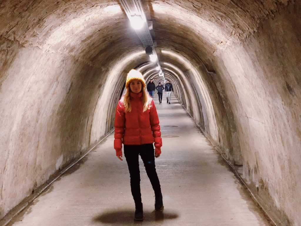 Woman with a red jacket at Grič Tunnel in Zagreb