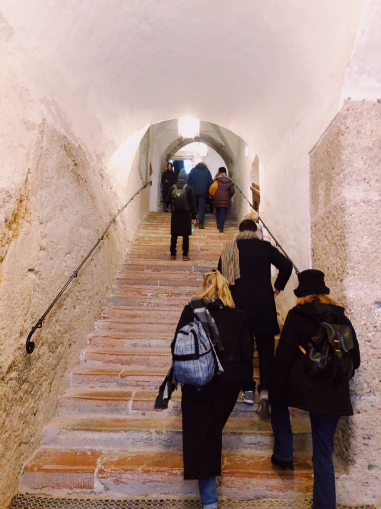 A staircase inside the Hohensalzburg fortress with people