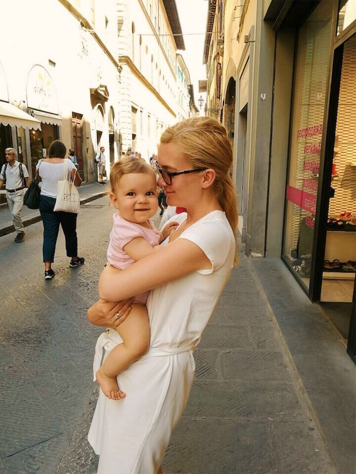 Mother and baby girl at a street in Florence, Italy