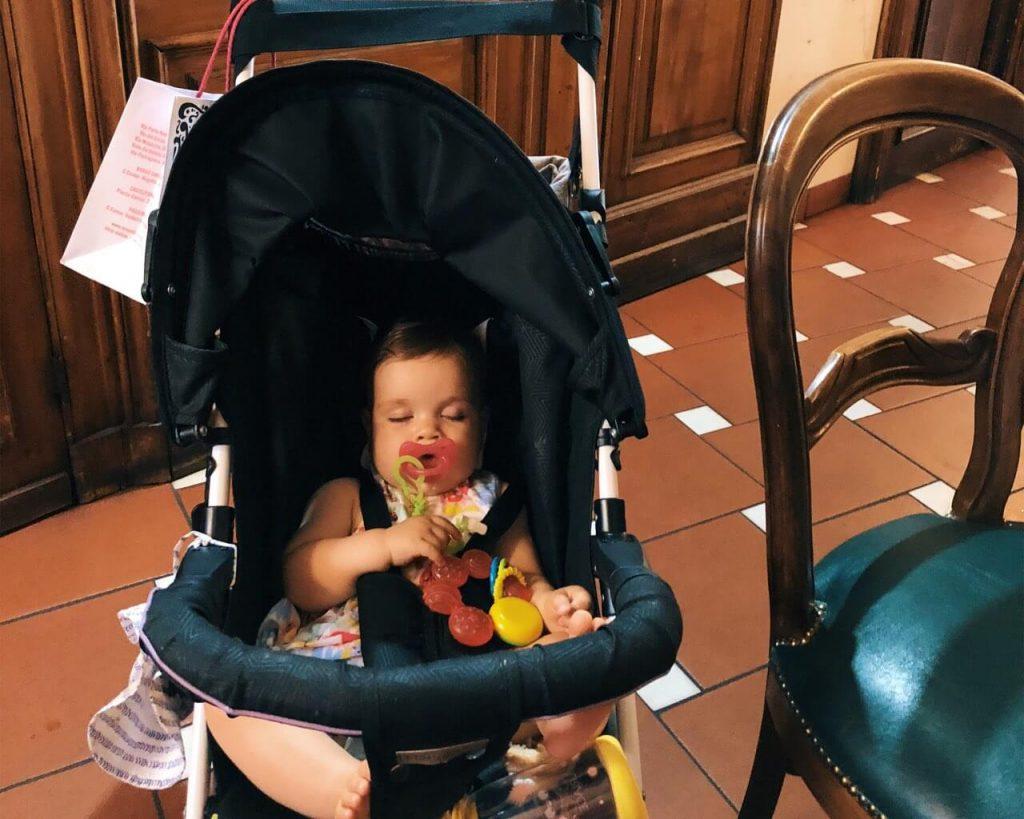 Baby girl asleep in Vivoli in Florence