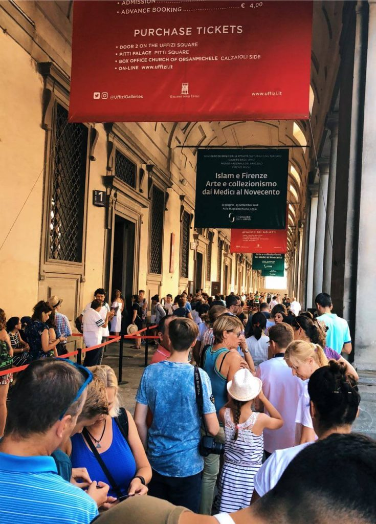 Line of people waiting to get in Uffizi gallery in Florence, Italy