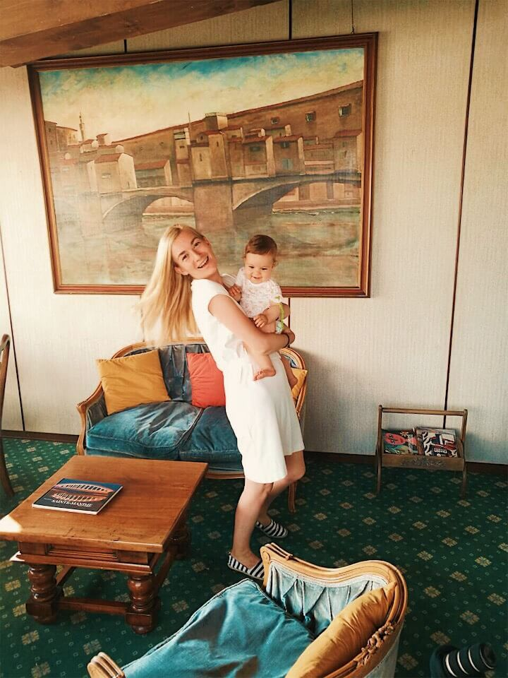 Mother and baby girl smiling and hugging in Florence