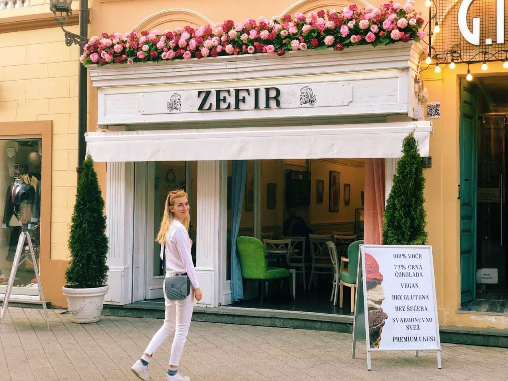 Woman in front of ice cream shop in Novi Sad