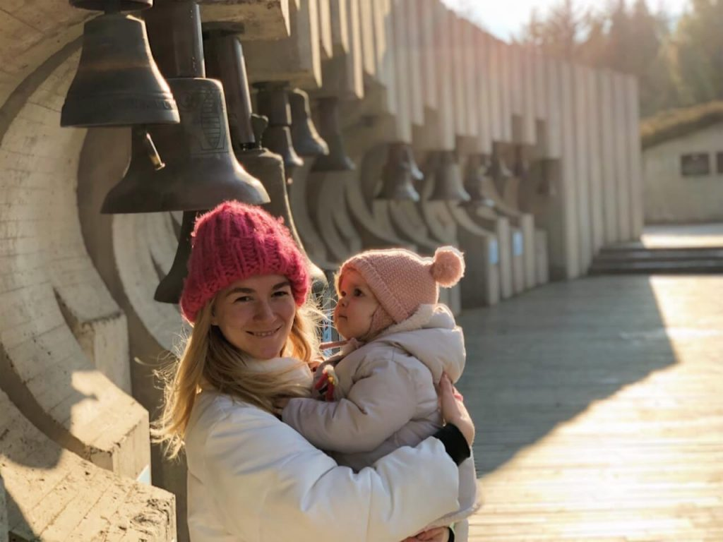 Mother and baby posing at children monument The Bells in Sofia