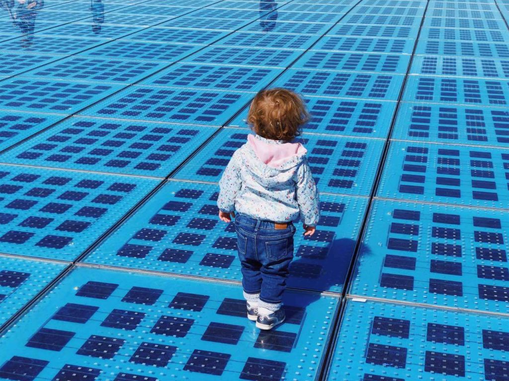 baby girl at the Monument to the Sun in Zadar