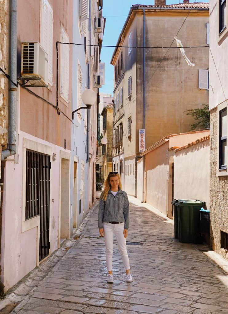 Woman smiling in old town of Zadar