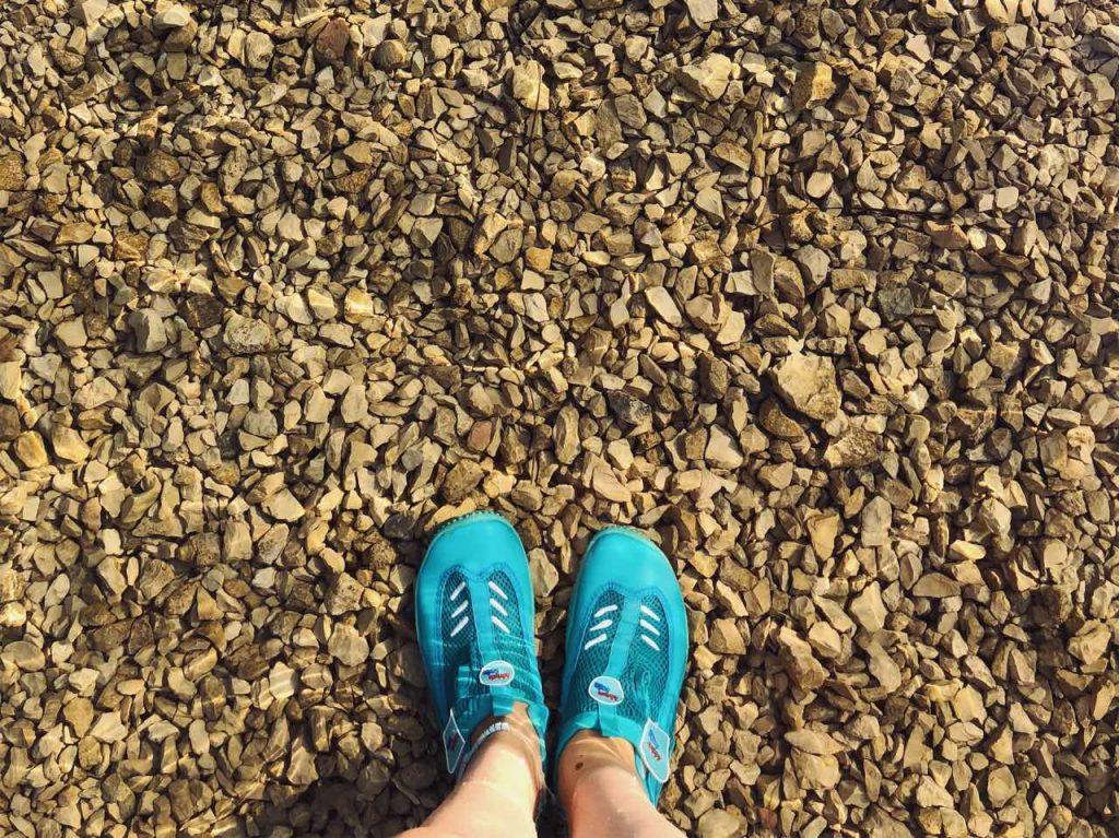 Aqua shoes on a beach in Croatia
