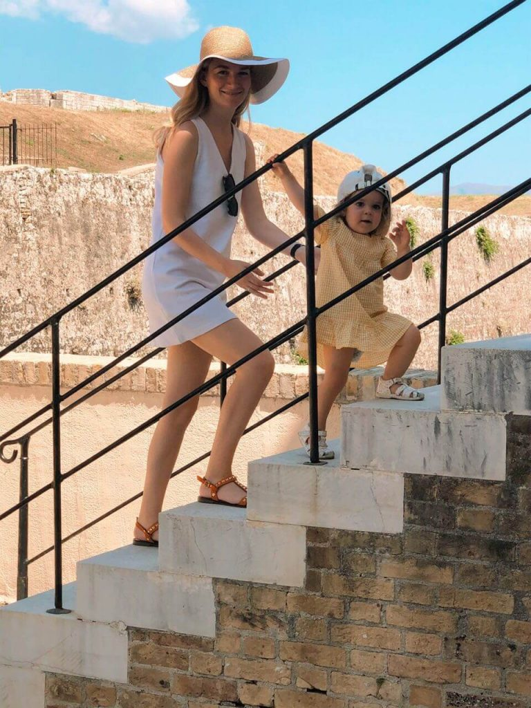 Mother and kid climbing stairs in Corfu