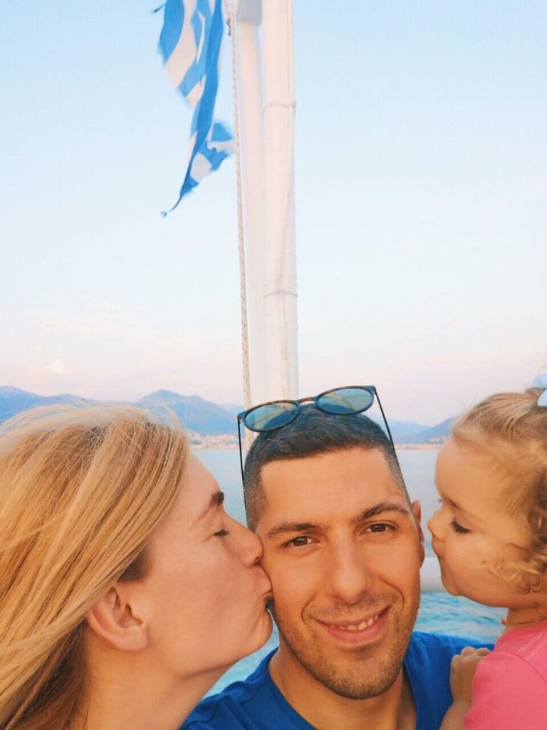 Happy family on a ferry in Greece