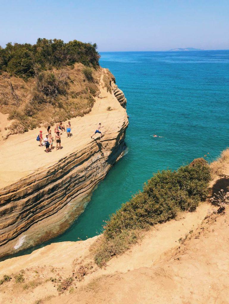 People kumping from rocks in Corfu