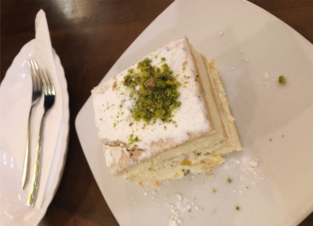 A cremeschnitte with pistachio