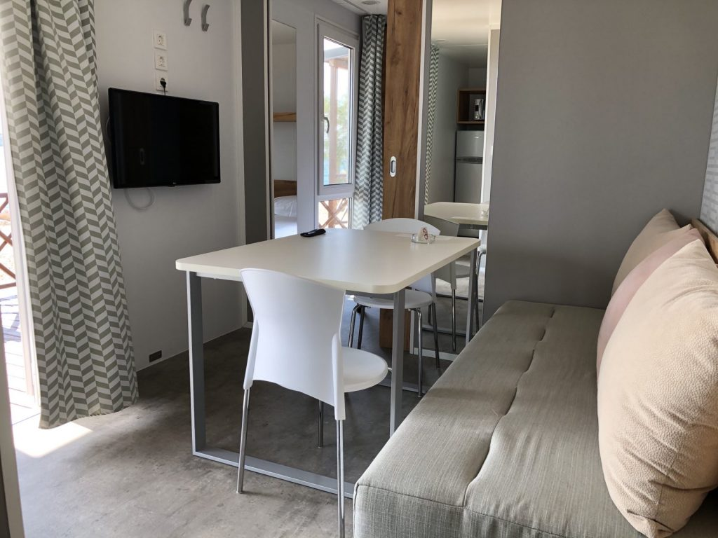 The inside eating area in a luxury mobile home at Amadria Park